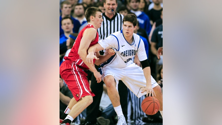 Illinois State's Jon Ekey, left, guards Creighton's Doug McDermott in the first half of an NCAA college basketball game in Omaha, Neb., Saturday, Feb. 9, 2013. (AP Photo/Nati Harnik)