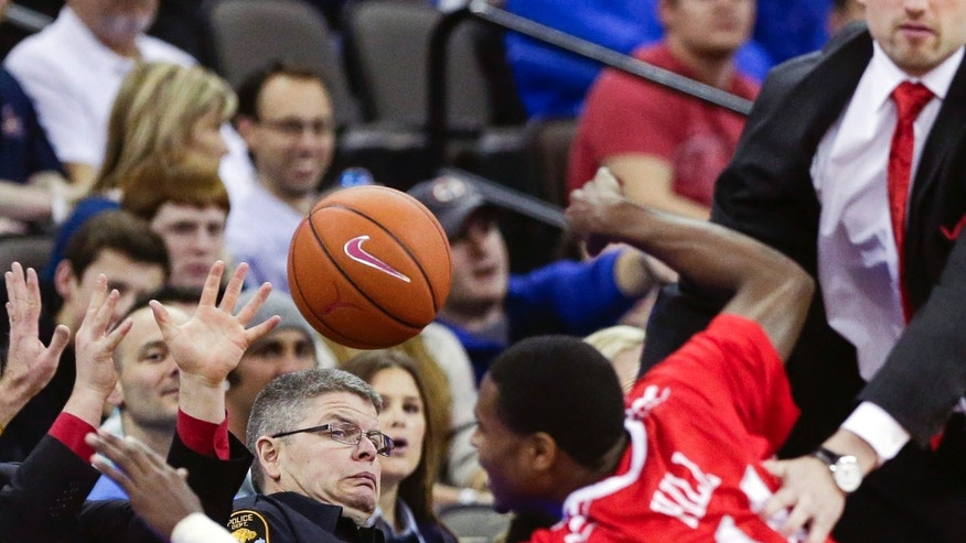 Illinois State's Johnny Hill tries to save an out-of-bounds ball in the first half of an NCAA college basketball game against Creighton, in Omaha, Neb., Saturday, Feb. 9, 2013. (AP Photo/Nati Harnik)