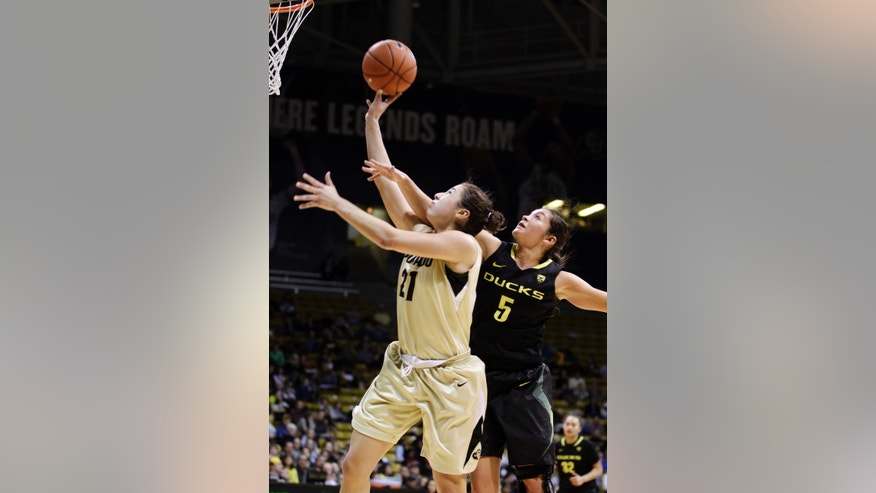 Colorado's Jasmine Sborov (21) shoots as Oregon's Jordan Loera defends during the second half of an NCAA college basketball game in Boulder, Colo., Sunday, Feb. 10, 2013. Colorado won 84-59. (AP Photo/Brennan Linsley)