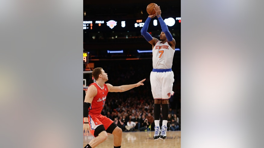 New York Knicks' Carmelo Anthony (7) shoots over Los Angeles Clippers' Blake Griffin (32) during the first half of an NBA basketball game on Sunday, Feb. 10, 2013, in New York. (AP Photo/Frank Franklin II)