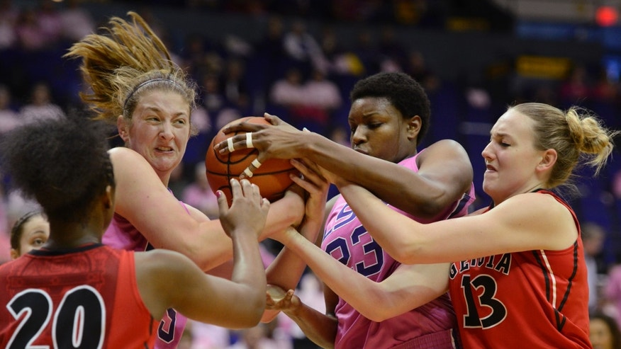 Georgia's Shacobia Barbee (20) and Merritt Hempe (13) battle for a rebound with LSU's Theresa Plaisance (55) and Shanece McKinney (23) during the first half of an NCAA college basketball game  at the Pete Maravich Assembly Center in Baton Rouge, La., Sunday, Feb. 10, 2013. (AP Photo/Bill Feig)
