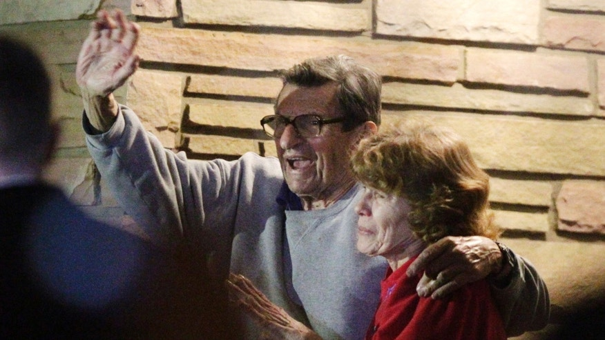 "FILE - In this Nov. 9, 2011 file photo, former Penn State Coach Joe Paterno and his wife, Sue Paterno, stand on their porch to thank supporters gathered outside their home in State College, Pa.  Breaking more than a year of silence, Sue Paterno is defending her late husband as a ""moral, disciplined"" man who never twisted the truth to avoid bad publicity. The wife of the former Penn State coach is fighting back against the accusations against Joe Paterno that followed the Jerry Sandusky scandal. Her campaign started with a letter sent Friday Feb. 8, 2013, to former Penn State players. (AP Photo/Gene J. Puskar, File)"