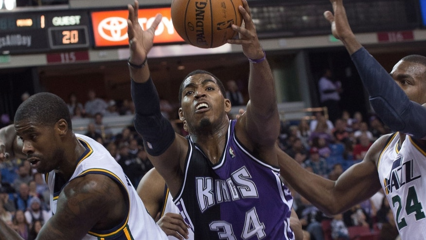 Sacramento Kings forward Jason Thompson (34) grabs a rebound against the Utah Jazz during an NBA basketball game on Saturday, Feb. 9, 2013,  in Sacramento, Calif.  (AP Photo/The Sacramento Bee, Randall Benton) MAGS OUT; TV OUT (KCRA3, KXTV10, KOVR13, KUVS19, KMAZ31, KTXL40) MANDATORY CREDIT