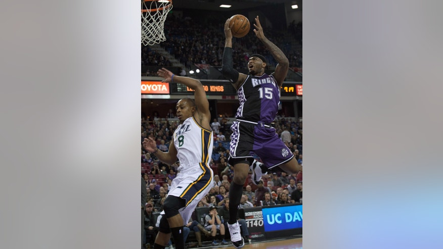 Sacramento Kings' center DeMarcus Cousins (15) scores  against the Utah Jazz during an NBA basketball game on Saturday, Feb. 9, 2013,  in Sacramento, Calif.  (AP Photo/The Sacramento Bee, Randall Benton) MAGS OUT; TV OUT (KCRA3, KXTV10, KOVR13, KUVS19, KMAZ31, KTXL40) MANDATORY CREDIT