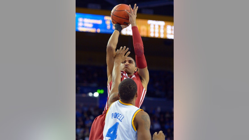 Washington State guard Mike Ladd, top, puts up a shot as UCLA guard Norman Powell defends during the first half of their NCAA college basketball game, Saturday, Feb. 9, 2013, in Los Angeles. (AP Photo/Mark J. Terrill)