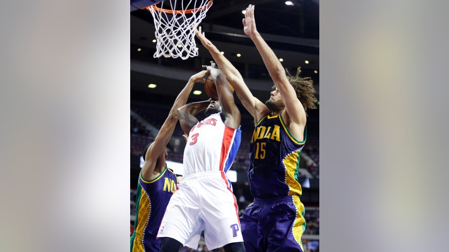 Detroit Pistons guard Rodney Stuckey (3) is defended while going to the basket by New Orleans Hornets forward Anthony Davis, left, and center Robin Lopez (15) in the first half of an NBA basketball game, Monday, Feb. 11, 2013, in Auburn Hills, Mich. (AP Photo/Duane Burleson)