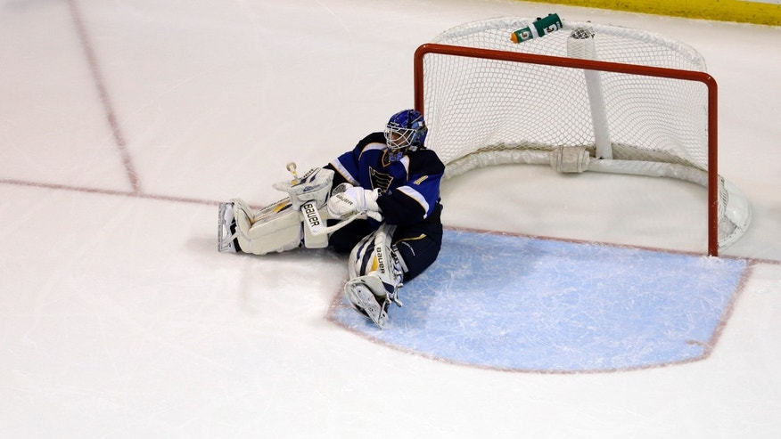 St. Louis Blues goalie Brian Elliott sits on the ice after giving up a goal to Los Angeles Kings' Jeff Carter during the second period of an NHL hockey game, Monday, Feb. 11, 2013, in St. Louis. The goal was Carter's second of the game against Elliott. (AP Photo/Jeff Roberson)