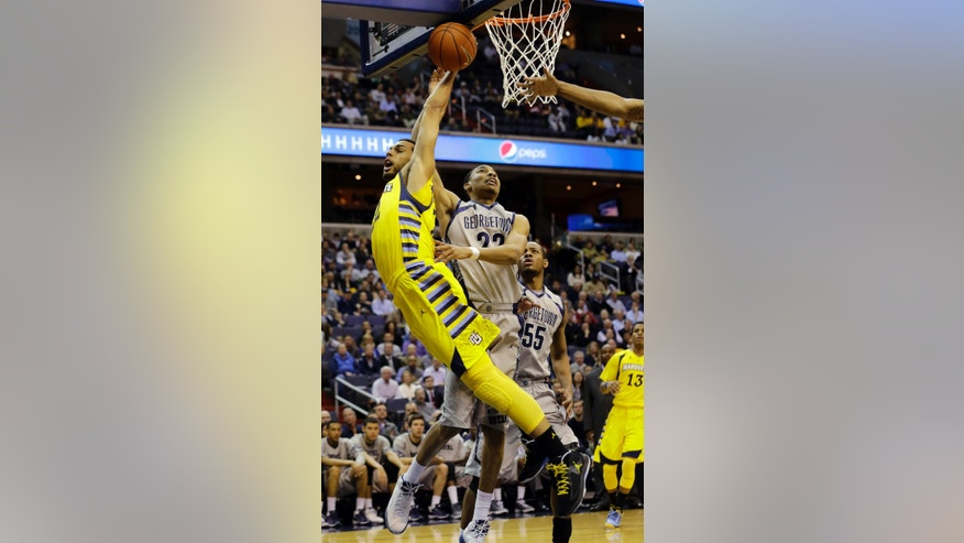Marquette guard Trent Lockett (22) is fouled by Georgetown forward Otto Porter Jr. (22) during the first half of an NCAA college basketball game, Monday, Feb. 11, 2013, in Washington. (AP Photo/Alex Brandon)