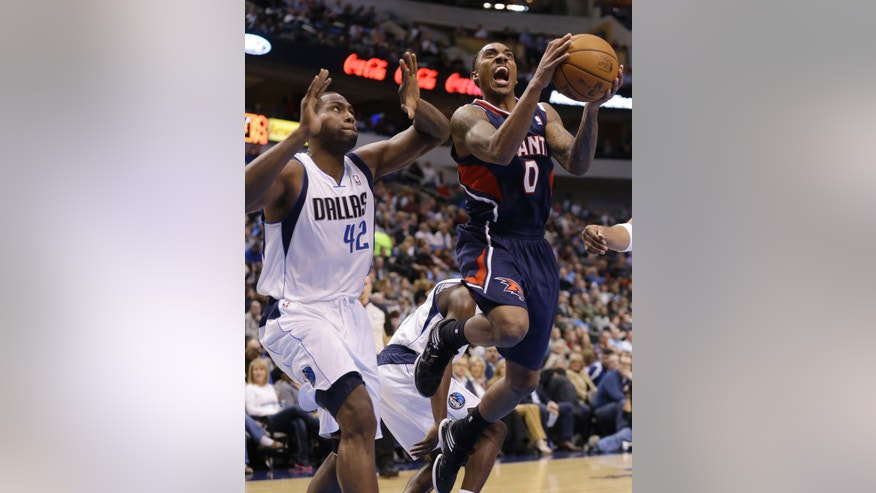 Atlanta Hawks guard Jeff Teague (0) drives to score past Dallas Mavericks forward Elton Brand (42) during the first half of an NBA basketball game, Monday, Feb. 11, 2013, in Dallas. (AP Photo/LM Otero)