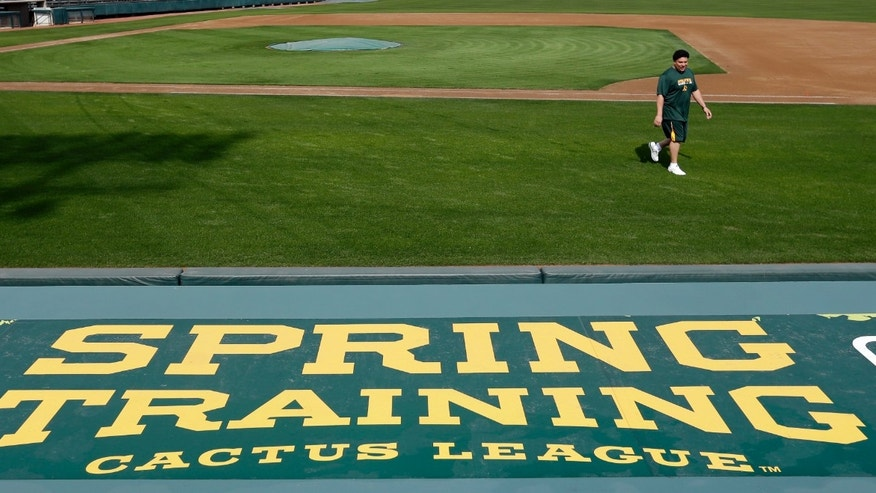 Oakland Athletics' Bartolo Colon walks back to the dugout after his physical Monday, Feb. 11, 2013, in Phoenix. The Athletics' pitchers and catchers start practice Tuesday. (AP Photo/Darron Cummings)