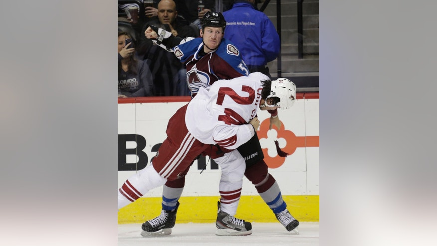 Colorado Avalanche left wing Cody McLeod (55) swings at Phoenix Coyotes center Kyle Chipchura (24) during a fight in the first period of an NHL hockey game, Monday, Feb. 11, 2013, in Denver. (AP Photo/Joe Mahoney)