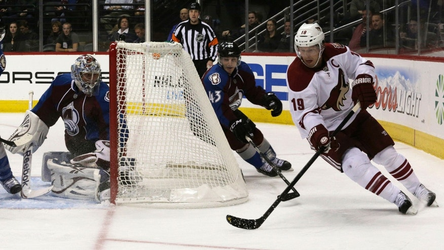 Phoenix Coyotes right wing Shane Doan (19) carries the puck to score against Colorado Avalanche center Michael Sgarbossa (43) and Colorado Avalanche goalie Semyon Varlamov (1) during the first period of an NHL hockey game, Monday, Feb. 11, 2013, in Denver. (AP Photo/Joe Mahoney)
