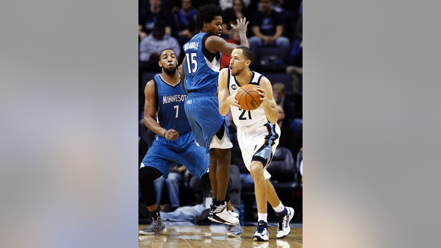 Memphis Grizzlies forward Tayshaun Prince (21) gets past Minnesota Timberwolves forwards Derrick Williams (7) and Mickael Gelabale (15) in the first half of an NBA basketball game, Sunday, Feb. 10, 2013, in Memphis, Tenn. (AP Photo/Lance Murphey)