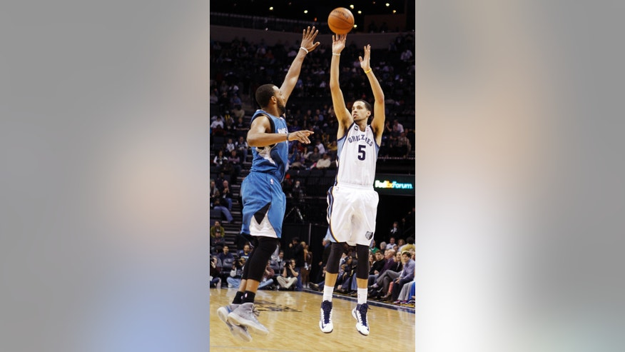 Memphis Grizzlies forward Austin Daye (5) shoots against Minnesota Timberwolves forward Derrick Williams (7) in the second half of an NBA basketball game, Sunday, Feb. 10, 2013, in Memphis, Tenn. The Grizzlies won 105-88. (AP Photo/Lance Murphey)