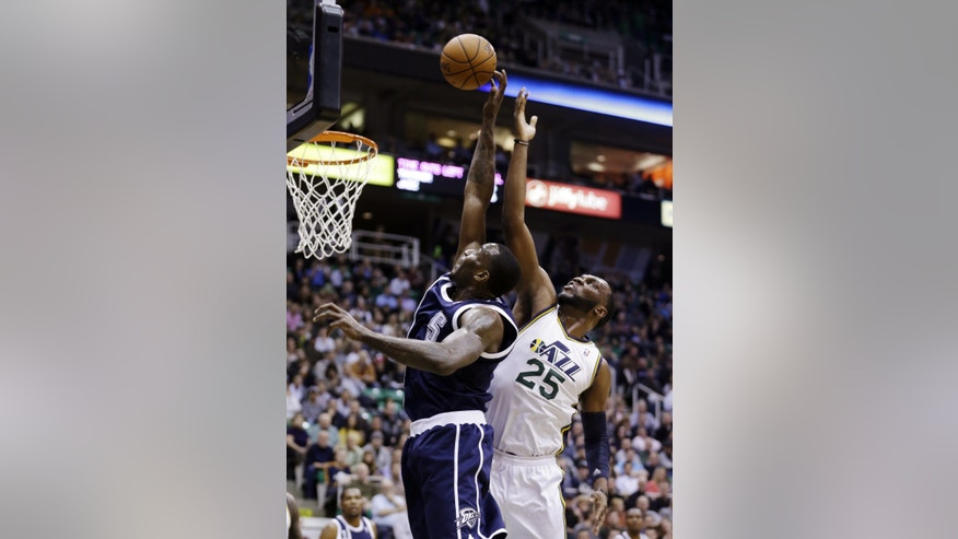 Oklahoma City Thunder's Kendrick Perkins (5) shoots as Utah Jazz's Al Jefferson (25) defends in the first quarter of an NBA basketball game, Tuesday, Feb. 12, 2013, in Salt Lake City. (AP Photo/Rick Bowmer)