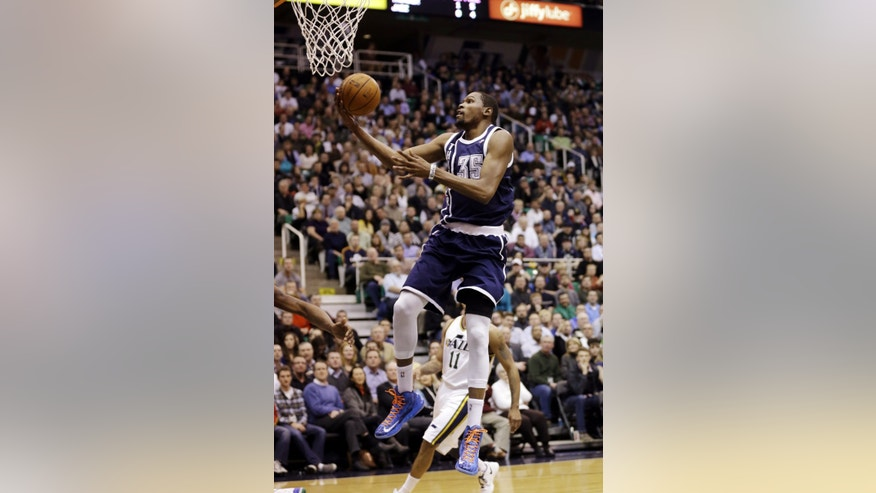Oklahoma City Thunder's Kevin Durant (35) lays the ball up in the second quarter of an NBA basketball game against the Utah Jazz, Tuesday, Feb. 12, 2013, in Salt Lake City. (AP Photo/Rick Bowmer)