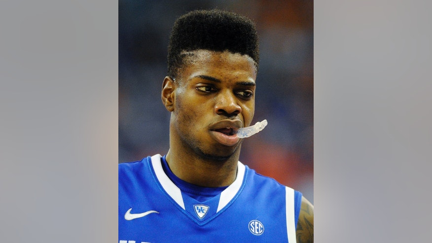 Kentucky forward Nerlens Noel (3) chews on his mouthpiece during the second half of an NCAA college basketball game against Florida in Gainesville, Fla., Tuesday, Feb. 12, 2013. Florida won 69-52. (AP Photo/Phil Sandlin)