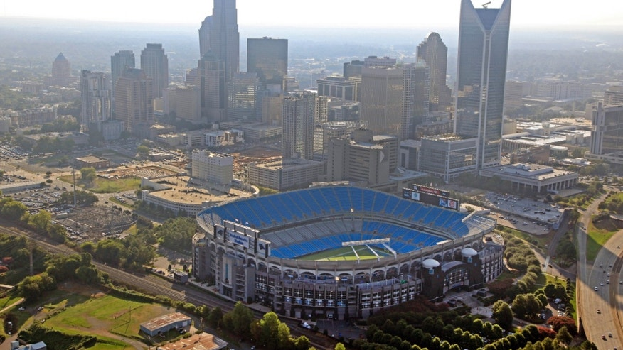 FILE - In this Aug. 16, 2012 file photo, the skyline of Charlotte, N.C., rises behind Bank of America Stadium in this aerial photo. Carolina Panthers president Danny Morrison tells The Associated Press the team hopes to begin his stadium renovation process immediately after the upcoming 2013 season and discusses what the team views as its top projects to help enhance the overall fan experience. (AP Photo/Chuck Burton, File)