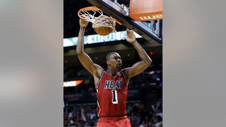 Miami Heat's Chris Bosh (1) scores against the Portland Trail Blazers during the first half of an NBA basketball game in Miami, Tuesday, Feb. 12, 2013. (AP Photo/Alan Diaz)