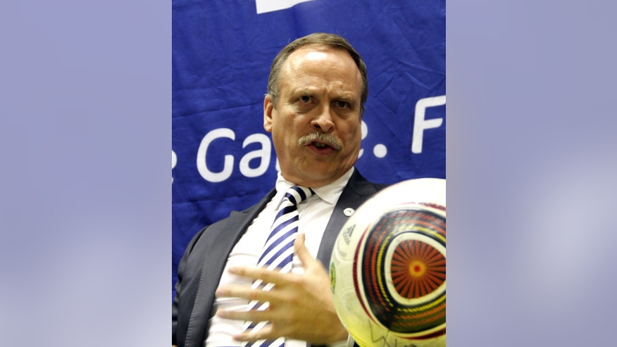 "FILE - In this Sept. 26, 2011 file photo Chris  Eaton, FIFA head of Security, addresses a press conference in Harare, Zimbawe. Soccer is falling under a cloud of suspicion as never before, sullied by a multibillion-dollar web of match-fixing that is staining increasingly larger parts of the world's most popular sport. ""Football is in a disastrous state,"" said Chris Eaton, director of sport integrity at the International Centre for Sport Security (ICSS). ""(The) fixing of matches for criminal gambling fraud purposes is absolutely endemic worldwide ... arrogantly happening daily.""  (AP Photo/Tsvangirayi Mukwazhi, File)"