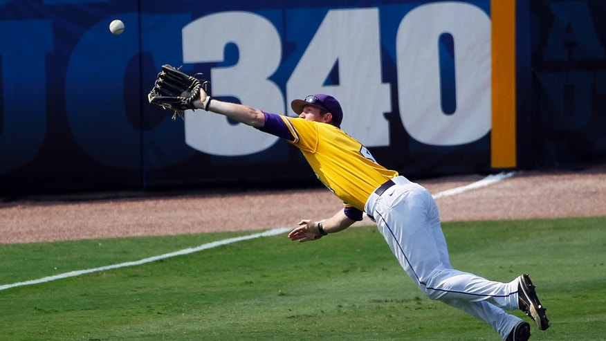 FILE - In this May 25, 2012, file photo, LSU left fielder Raph Rhymes making a diving catch to end the second inning of a NCAA college baseball game against Mississippi State at the Southeastern Conference tournament in Hoover, Ala. Rhymes flirted with .500 for much of last season and finished with a nation-leading .431 average to become the first LSU player to lead the NCAA in batting.  (AP Photo/Dave Martin, File)