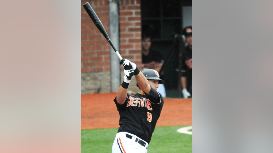 FILE - In this March 25, 2012, file photo,  Oregon State's Michael Conforto hits a home run against Arizona during an NCAA college baseball game in Corvallis, Ore. Conforto led the Beavers with a .349 average and led the Pac-12 with 76 RBIs and tied for the conference lead with 13 homers. (AP Photo/The Corvallis Gazette-Times, Jesse Skoubo) MAGS OUT,  NO SALES, EDITORIAL USE ONLY