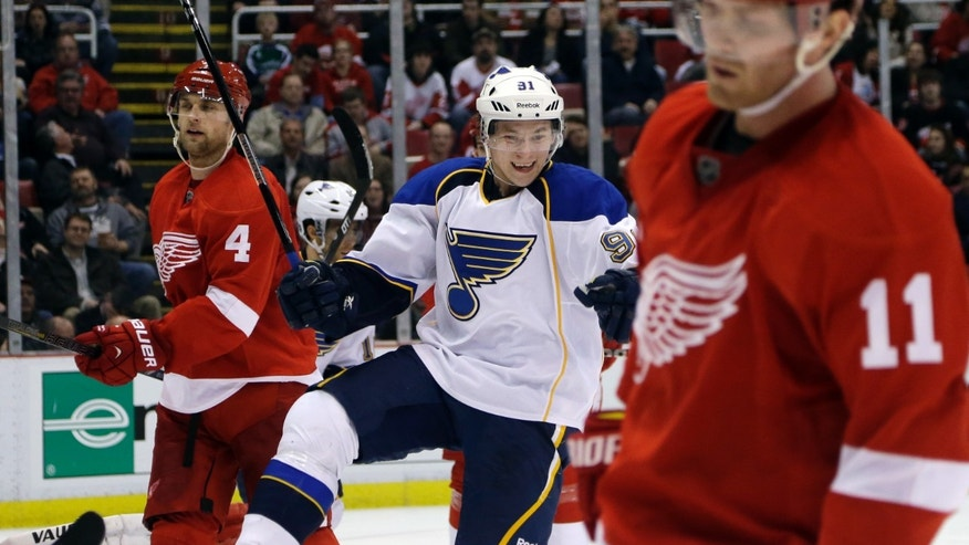 St. Louis Blues right wing Vladimir Tarasenko (91), of Russia, skates between Detroit Red Wings defenseman Jakub Kindl (4), of the Czech Republic, and right wing Daniel Cleary (11) while celebrating his goal during the second period of an NHL hockey game in Detroit, Wednesday, Feb. 13, 2013. (AP Photo/Carlos Osorio)