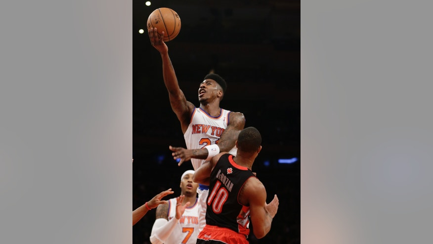 New York Knicks' Iman Shumpert (21) shoots over Toronto Raptors' DeMar DeRozan (10) during the first half of an NBA basketball game Wednesday, Feb. 13, 2013, in New York. (AP Photo/Frank Franklin II)