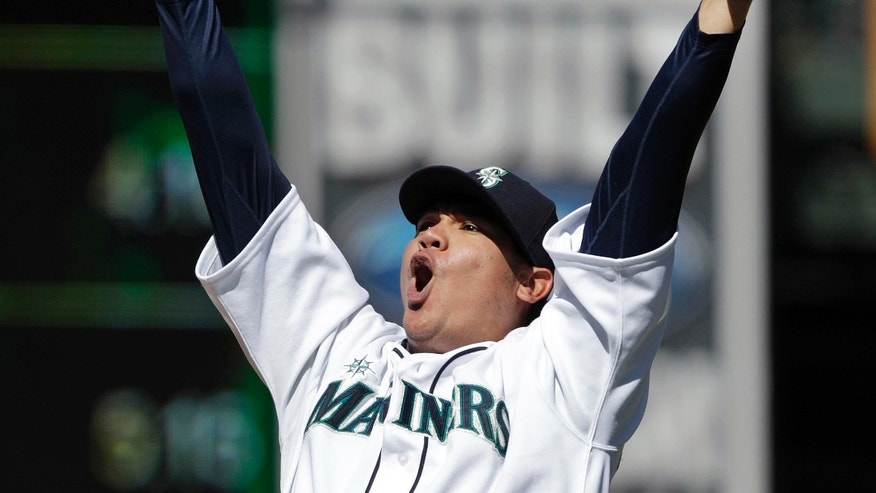 In this Aug. 15, 2012, file photo, Seattle Mariners pitcher Felix Hernandez reacts after throwing a perfect game against the Tampa Bay Rays in Seattle.