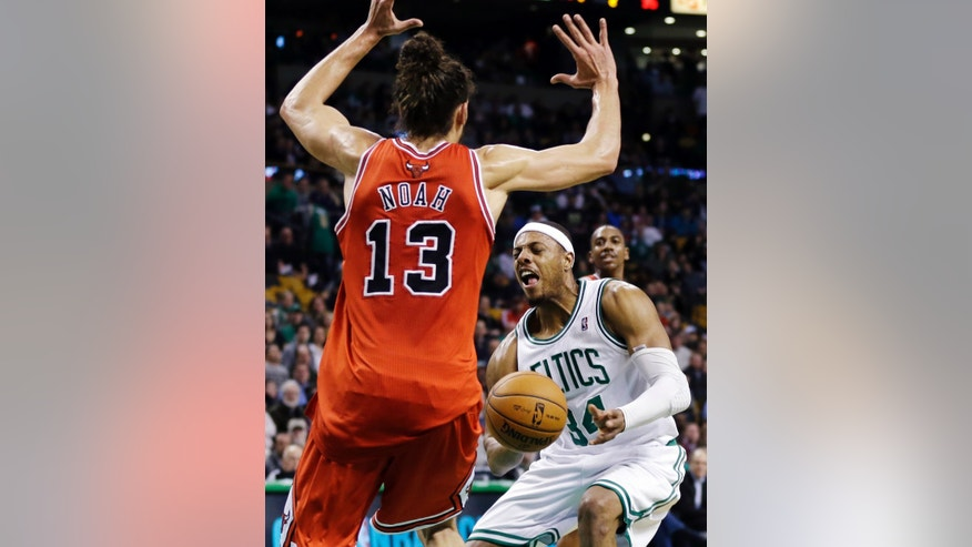 Chicago Bulls center Joakim Noah (13) defends against Boston Celtics forward Paul Pierce (34) during the second quarter of an NBA basketball game in Boston, Wednesday, Feb. 13, 2013. (AP Photo/Elise Amendola)