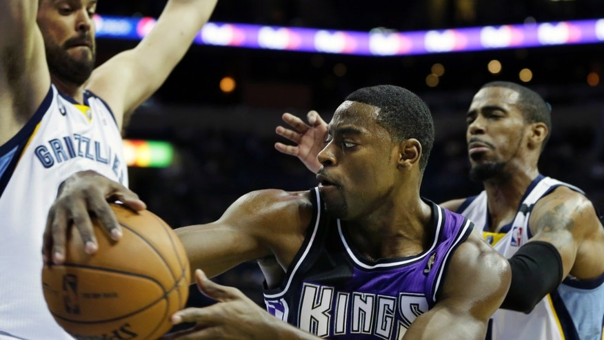 Sacramento Kings guard Tyreke Evans, center, is pressured by Memphis Grizzlies center Marc Gasol, of Spain, left, and Mike Conley (11) during the first half of an NBA basketball game in Memphis, Tenn., Tuesday, Feb. 12, 2013. (AP Photo/Danny Johnston)