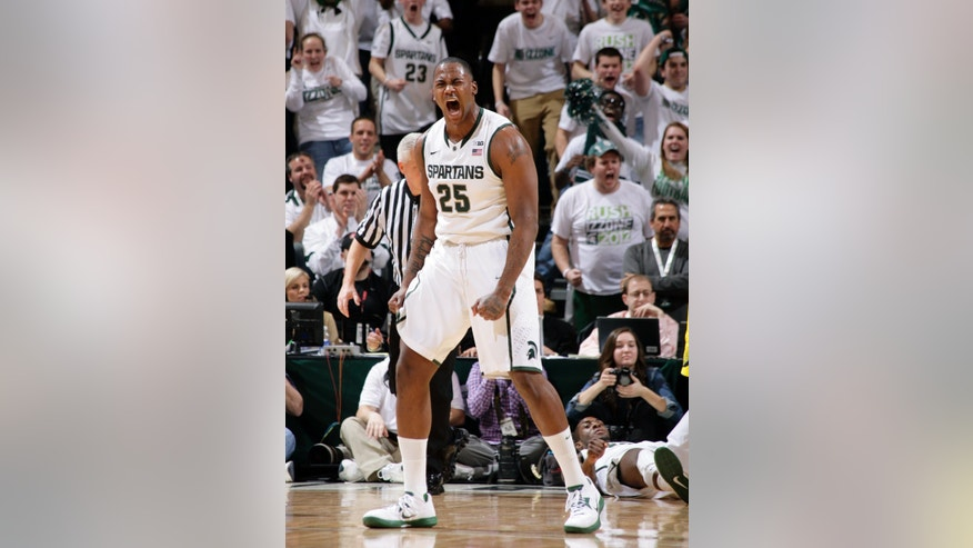 Michigan State's Derrick Nix (25) reacts after Branden Dawson, right, scored and drew a foul against Michigan during the first half of an NCAA college basketball game, Tuesday, Feb. 12, 2013, in East Lansing, Mich. (AP Photo/Al Goldis)