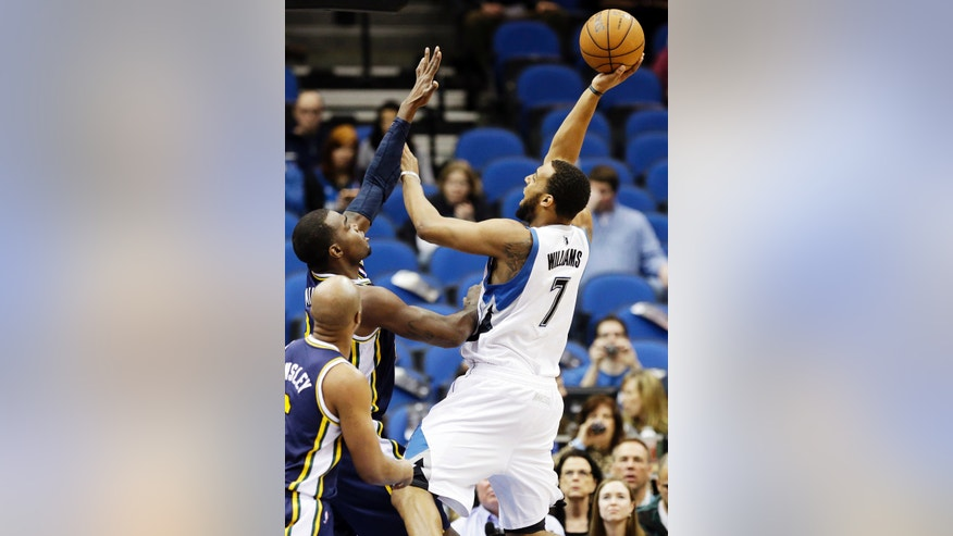 Minnesota Timberwolves' Derrick Williams (7) shoots as Utah Jazz's Paul Millsap defends in the first quarter of an NBA basketball game, Wednesday, Feb. 13, 2013, in Minneapolis. (AP Photo/Jim Mone)