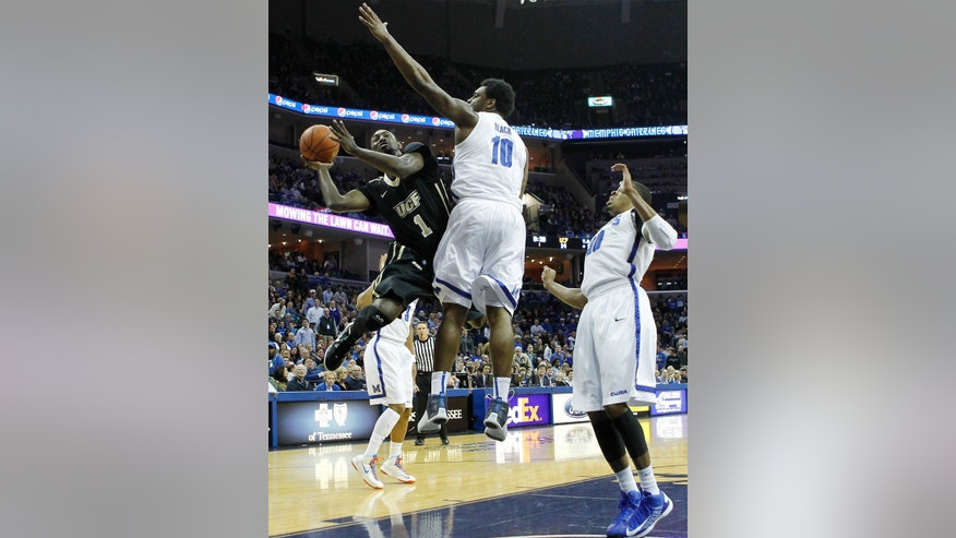 Central Florida forward Tristan Spurlock (1) shoots against Memphis forwards Tarik Black (10) and D.J. Stephens (30) in the first half of an NCAA college basketball game on Wednesday, Feb. 13, 2013, in Memphis, Tenn. (AP Photo/Lance Murphey)