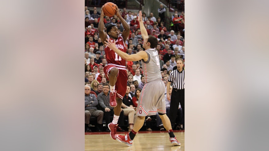 Indiana's Kevin Ferrell, left, passes the ball as Ohio State's Aaron Craft defends during the second half of an NCAA college basketball game on Sunday, Feb. 10, 2013, in Columbus, Ohio. Indiana defeated Ohio State 81-68. (AP Photo/Jay LaPrete)