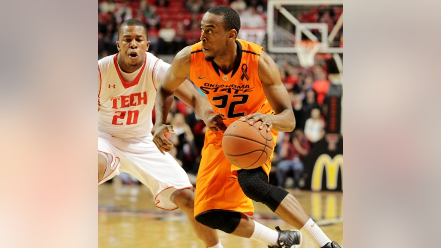 Oklahoma State's Markel Brown (22) drives against Texas Tech's Toddrick Gotcher (20) during their NCAA college basketball game, Wednesday, Feb. 13, 2013, in Lubbock, Texas. (AP Photo/The Avalanche-Journal, Zach Long) ALL LOCAL TV OUT