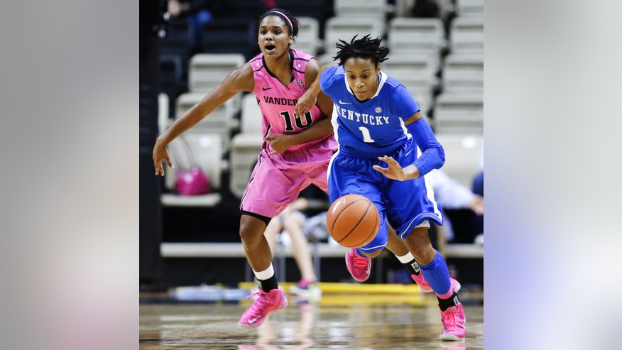 Kentucky guard A'dia Mathies (1) steals the ball from Vanderbilt guard Christina Foggie (10) in the first half of an NCAA college basketball game, Sunday, Feb. 10, 2013, in Nashville, Tenn. (AP Photo/Mark Humphrey)