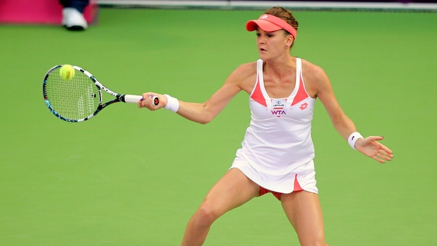 Agnieszka Radwanska of Poland returns the ball during her match against Anastasia Rodionova of Australia  on the Third Day of the WTA Qatar Ladies Open in Doha, Qatar, Wednesday, Feb. 13, 2013. (AP Photo/Osama Faisal)