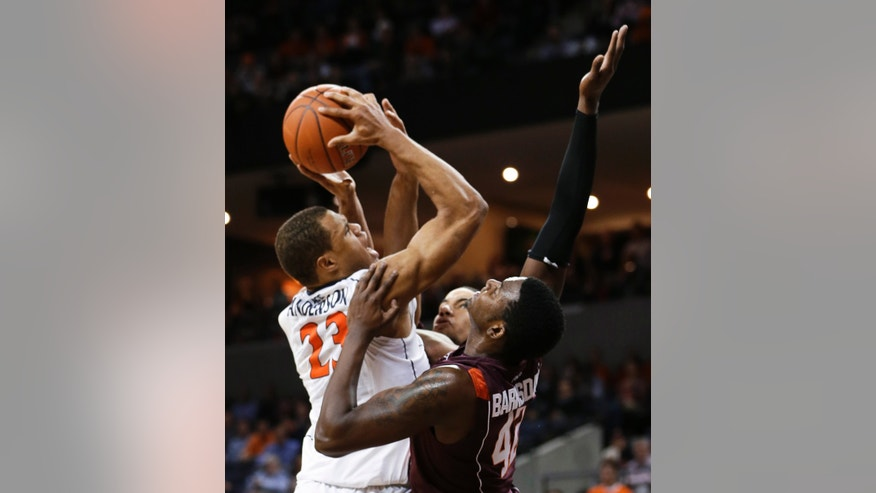 Virginia guard Justin Anderson (23) draws a foul from Virginia Tech forward C.J. Barksdale (42) during the second half of an NCAA college basketball game Tuesday, Feb. 12, 2013, in Charlottesville, Va. Virginia won 73-55. (AP Photo/Steve Helber)