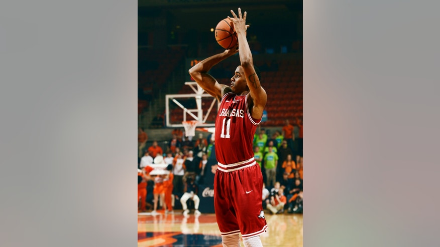 Arkansas' BJ Young shoots against Auburn in the first half of their NCAA college basketball game, Wednesday, Feb. 13, 2013, in Auburn, Ala. (AP Photo/Todd J. Van Emst)