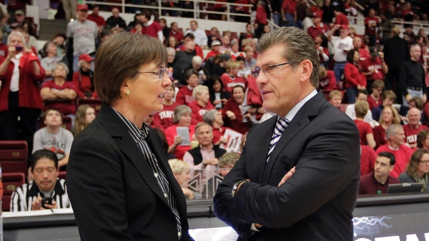 ADVANCE FOR WEEKEND EDITIONS, FEB. 16-17 - FILE - In this Dec. 29, 2012, file photo, Connecticut head coach Geno Auriemma, right, talks with Stanford head coach Tara VanDerveer before the start of an NCAA college basketball game in Stanford, Calif. Auriemma, VanDerveer and Andy Landers,at Georgia, are all within reach of joining the 900-win club in the next few years. A few others have a shot at it, including Notre Dame's Muffet McGraw, who just passed the 700-victory plateau. But after the Notre Dame coach it would be difficult to see anyone making a run at that number.  (AP Photo/Tony Avelar, File)