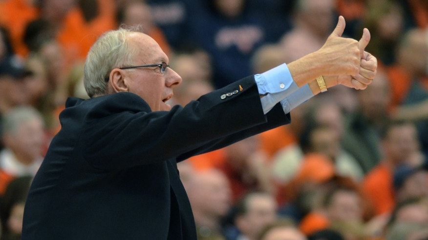 Syracuse head coach Jim Boeheim wants a jump-ball call from the officials during the second half against St. John's in an NCAA college basketball game in Syracuse, N.Y., Sunday, Feb. 10, 2013. Syracuse won 77-58. (AP Photo/Kevin Rivoli)