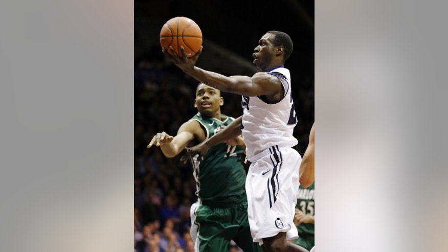 Butler forward Khyle Marshall, right, shoots over Charlotte center Mike Thorne in the first half of an NCAA college basketball game in Indianapolis, Wednesday, Feb. 13, 2013. (AP Photo/Michael Conroy)