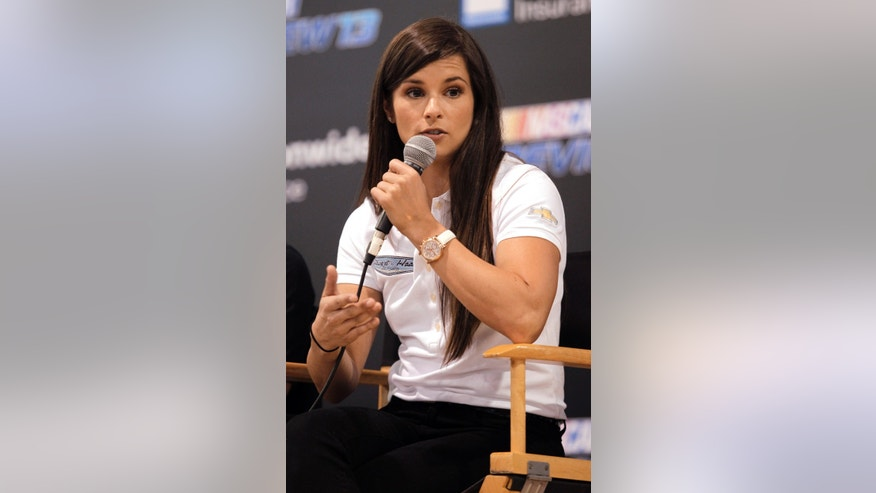 Danica Patrick talks to fans during a question and answer session at the NASCAR Preview 2013, Saturday Feb. 9, 2013, in Charlotte, N.C. (AP Photo/Bob Leverone)