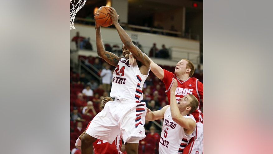 Fresno State's Marvelle Harris (24) grabs a rebound over New Mexico's Alex Kirk in the first half of an NCAA college basketball game in Fresno, Calif., Wednesday, Feb. 13, 2013. (AP Photo/Gary Kazanjian)