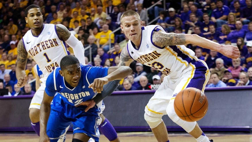 Creighton's Jahenns Manigat (12) and Northern Iowa's Marc Sonnen (23) fight for a loose ball during the first half of their NCAA college basketball game, Wednesday, Feb. 13, 2013, in Cedar Falls, Iowa. Northern Iowa won 61-54. (AP Photo/The World-Herald, Mark Davis) MAGS OUT; ALL NEBRASKA LOCAL BROADCAST TV OUT