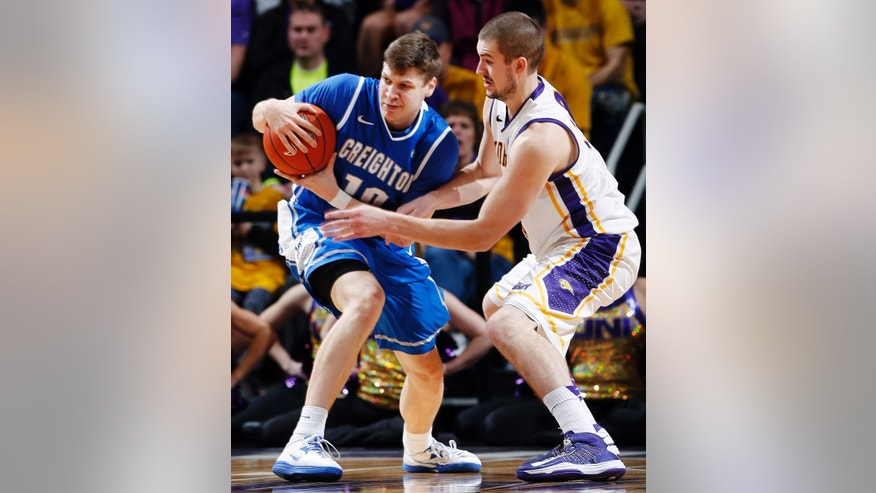 Northern Iowa forward Jake Koch, right, tries to poke the ball free from Creighton guard Grant Gibbs, left, during the first half of their NCAA college basketball game, Wednesday, Feb. 13, 2013, in Cedar Falls, Iowa. Northern Iowa won 61-54. (AP Photo/Waterloo Courier, Matthew Putney)