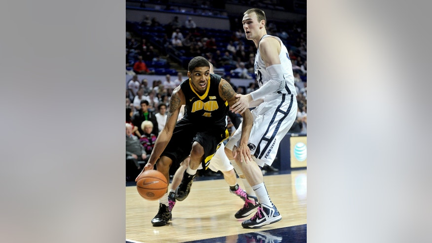 Iowa's Roy Devyn Marble, left, dribbles around Penn State's Alan Wisniewski during their NCAA college basketball game, Thursday, Feb. 14, 2013, in State College, Pa. Iowa won 74-72. (AP Photo/Centre Daily Times, Abby Drey) MANDATORY CREDIT; MAGS OUT
