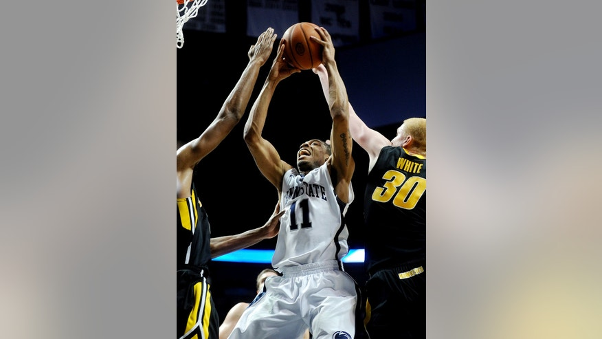 Penn State's Jermaine Marshall (11) shoots against Iowa's Aaron White (30) during their NCAA college basketball game, Thursday, Feb. 14, 2013, in State College, Pa. Iowa won 74-72. (AP Photo/Centre Daily Times, Abby Drey) MANDATORY CREDIT; MAGS OUT