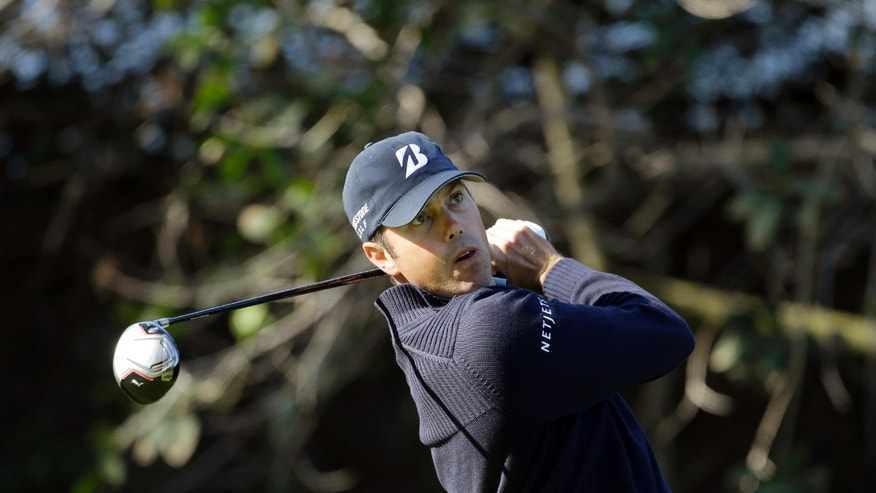 Matt Kuchar drives on the 11th tee during the first round of the Northern Trust Open golf tournament at Riviera Country Club in the Pacific Palisades area of Los Angeles Thursday, Feb. 14, 2013. (AP Photo/Reed Saxon)